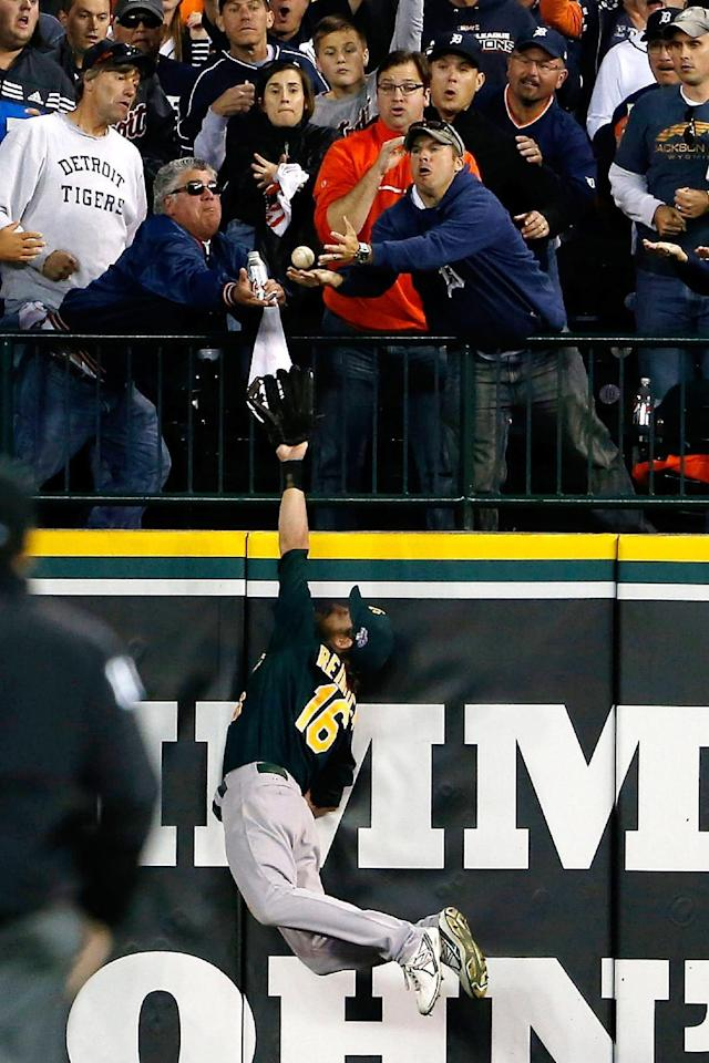 Oakland Athletics right fielder Josh Reddick stretches but is unable to catch a solo home run by Detroit Tigers' Victor Martinez during the seventh inning of Game 4 of baseball's American League division series in Detroit, Tuesday, Oct. 8, 2013. The Tigers won 8-6. (AP Photo/Grand Rapids Press, Mike Mulholland)