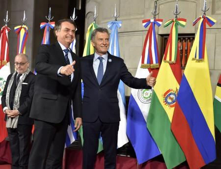 Argentina's President Mauricio Macri and his Brazilian counterpart Jair Bolsonaro pose at the 54th Summit of Heads of State of Mercosur and Associated States, in Santa Fe