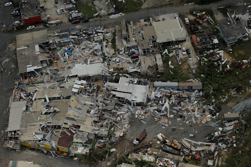 Aluminum roofing is seen twisted and thrown off buildings as recovery efforts continue following Hurricane Maria near San Jose, Puerto Rico, on Oct. 7. (Lucas Jackson / Reuters)