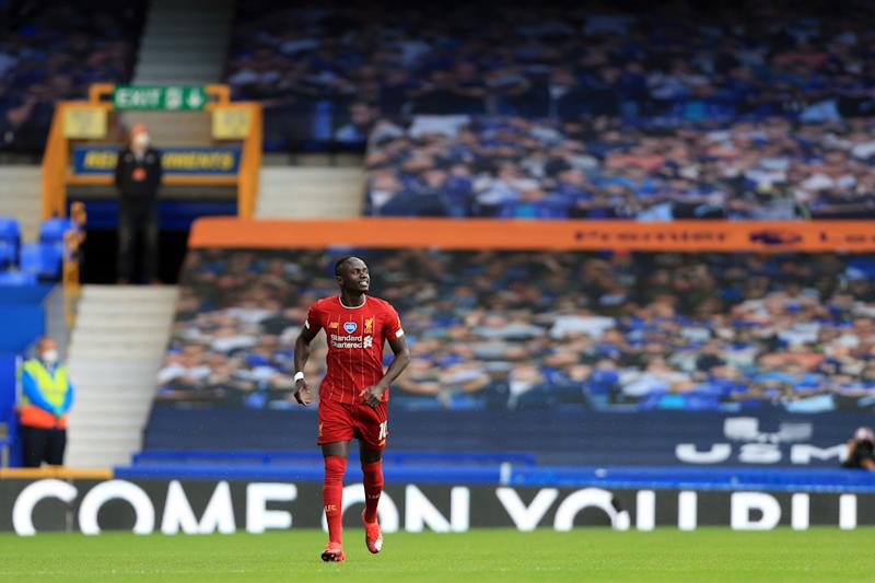 Liverpool's Sadio Mané jogs back to the midfield line after everyone else took a knee before Sunday's Merseyside derby. (Photo by Simon Stacpoole/Offside/Offside via Getty Images)