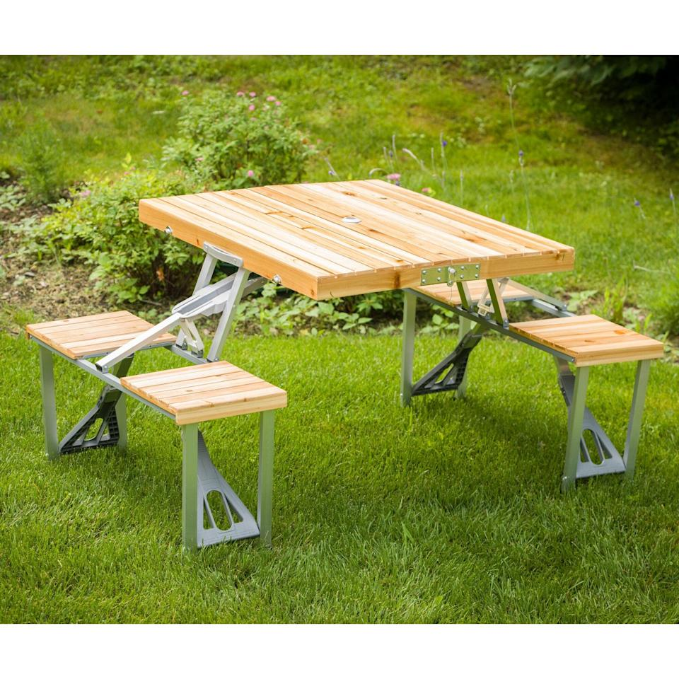 """<p>The design of this <a href=""""https://www.popsugar.com/buy/Shick-Picnic-Table-575512?p_name=Shick%20Picnic%20Table&retailer=wayfair.com&pid=575512&price=158&evar1=casa%3Aus&evar9=45910407&evar98=https%3A%2F%2Fwww.popsugar.com%2Fhome%2Fphoto-gallery%2F45910407%2Fimage%2F47487641%2FShick-Picnic-Table&list1=shopping%2Cfurniture%2Coutdoor%20entertaining%2Coutdoor%20decorating%2Cdecor%20shopping%2Chome%20shopping&prop13=api&pdata=1"""" class=""""link rapid-noclick-resp"""" rel=""""nofollow noopener"""" target=""""_blank"""" data-ylk=""""slk:Shick Picnic Table"""">Shick Picnic Table</a> ($158) is so smart, because you can fold it up easily.</p>"""