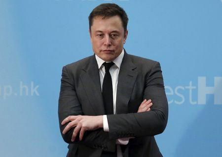 Tesla Chief Executive Elon Musk stands on the podium as he attends a forum on startups in Hong Kong China