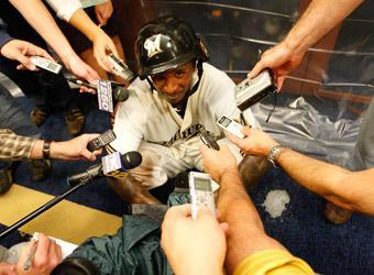 """Wearing his """"T-Plush"""" army helmet, Nyjer Morgan talks to reporters after Milwaukee's 3-2 victory over Arizona in Game 5 of the NLDS"""
