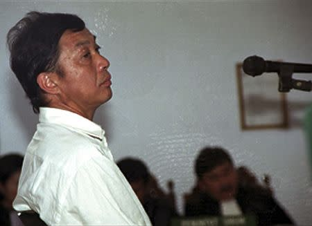 File picture shows Dutch citizen Ang Kiem Soei sitting in a Tangerang courtroom while awaiting sentencing