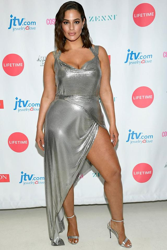 <p>A silver wrap dress with extreme leg split might not sound like it would work, but my god Ashley Graham pulls it off. Looking like a mermaid that just stepped out of the ocean, the model's goddess gown is all the inspo we need for summer weddings.  </p>