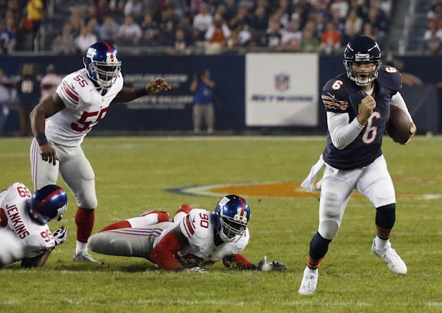 Chicago Bears quarterback Jay Cutler (6) scrambles past New York Giants defenders Cullen Jenkins (99), Keith Rivers (55) and Jason Pierre-Paul (90) in the first half of an NFL football game, Thursday, Oct. 10, 2013, in Chicago. (AP Photo/Charles Rex Arbogast)