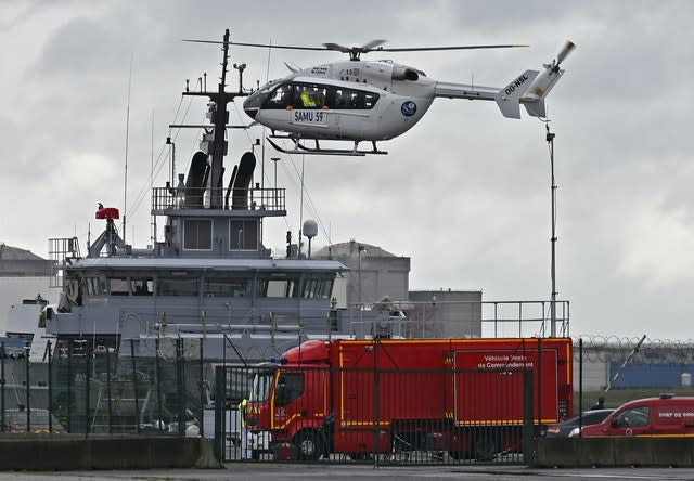 A French rescue helicopter lands close to a rescue vessel in Dunkirk, northern France, during the recovery operation
