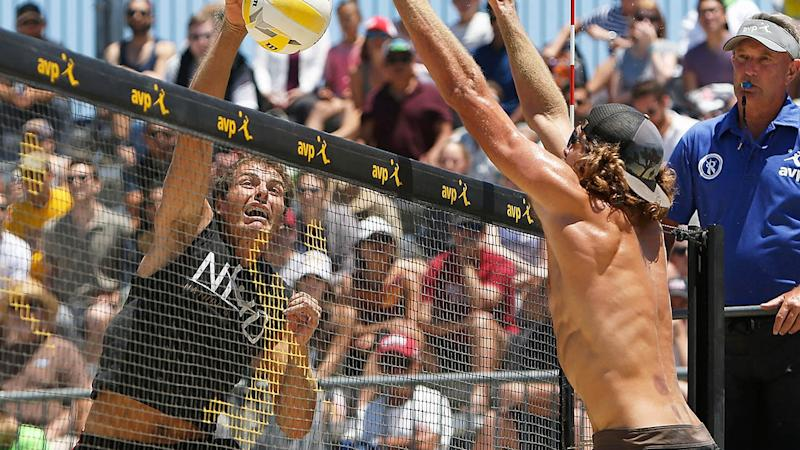 Eric Zaun spikes the ball past Jeremy Casebeer during day 3 of the AVP San Francisco Open at Pier 30-32 on July 8, 2017 in San Francisco, California. (Photo Lachlan Cunningham/Getty Images)