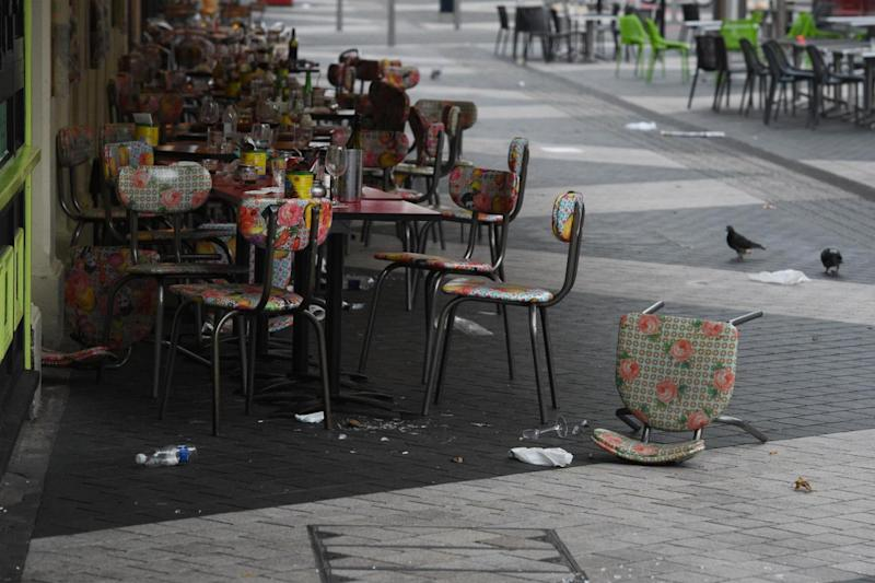 Empty tables in a restaurant near the Natural History Museum in South Kensington (EPA)