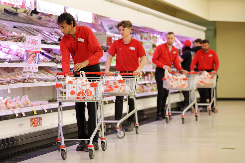 Staff at the Coles in Coburg pack boxes to donate to Melbourne residents on lockdown. Source: Supplied/Coles