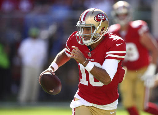FILE - In this Sept. 16, 2018, file photo, San Francisco 49ers quarterback Jimmy Garoppolo runs with the ball during the second half of an NFL football game against the Detroit Lions in Santa Clara, Calif. Garoppolo was perfect in five starts to finish last season, and while hes had trouble with interceptions the first two weeks, he's also a big reason why San Francisco won a shootout against the Lions last week. Garoppolo threw a pair of touchdown passes in the 30-27 victory. The 49ers play the Kansas City Chiefs this week. (AP Photo/Ben Margot, File)