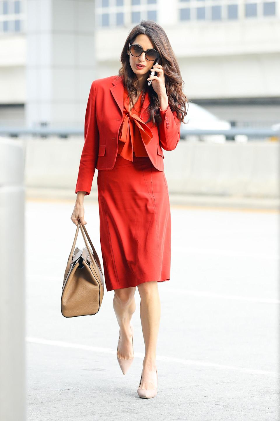 <p><strong>When: September 21, 2017</strong><br>Hiding coyly behind oversized sunglasses, the 39-year-old human rights lawyer showcased her amazing figure in a knee-length red Bottega Veneta skirt suit complemented with a pussy-bow blouse. Her long wavy locks ran loose down her back as she strutted the street in nude Manolo Blahnik pumps and carried an oversized Michael Kors purse. <em>(Photo: Splash News)</em> </p>