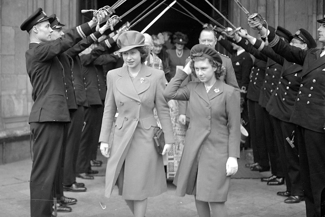 "<p>Princess Elizabeth and her sister <a rel=""nofollow"" href=""https://www.goodhousekeeping.com/life/a47365/princess-margaret-tony-armstrong-jones-marriage/"">Princess Margaret</a> leaving the wedding of Lt Wake Walker and Lady Anne Spencer.</p>"