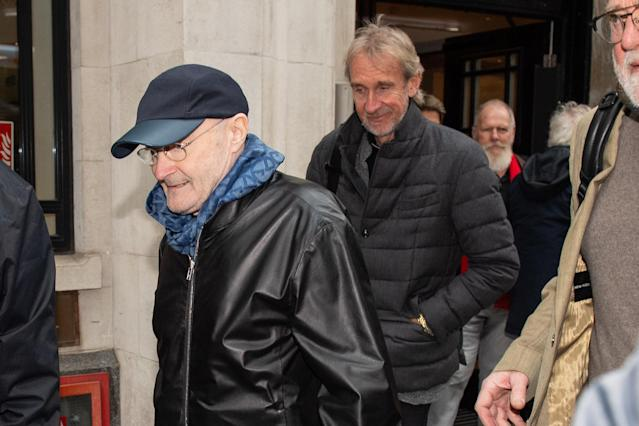 Phil Collins (left) and Mike Rutherford leave BBC Wogan House after appearing on Radio 2's Zoe Ball show, to announce that Genesis are to reform to tour the UK later this year. (Photo by Dominic Lipinski/PA Images via Getty Images)