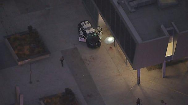 PHOTO: Law enforcement look at a vehicle at the Metro station in Compton where two Los Angeles sheriff's deputies were shot in an ambush on Saturday, Sept. 12, 2020. (KABC)