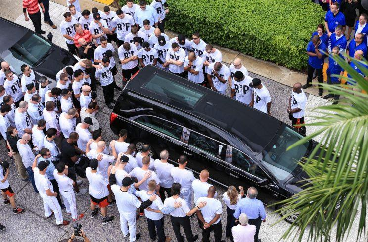 Miami Marlins players and members of the Marlins organization and their fans surround the hearse carrying Miami Marlins pitcher Jose Fernandez to pay their respects on September 28, 2016 in Miami, Florida. Mr. Fernandez was killed in a weekend boat crash in Miami Beach along with two friends. (Photo by Rob Foldy/Getty Images)