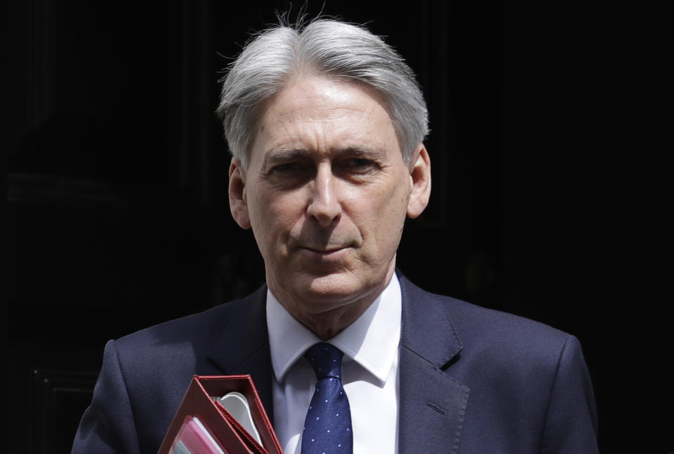 Britain's Chancellor Philip Hammond leaves 11 Downing Street to attend the weekly session of Prime Ministers Questions in Parliament in London, Wednesday, May 22, 2019. (AP Photo/Kirsty Wigglesworth)