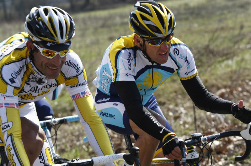 "FILE - This March 21, 2009 file photo shows Lance Armstrong, of the United States, beside fellow countryman George Hincapie, left, during the Milan-San Remo cycling classic in San Remo, Italy. The U.S. Anti-Doping Agency says 11 of Lance Armstrong's former teammates testified against him in its investigation of the cyclist, revealing ""the most sophisticated, professionalized and successful doping program that sport has ever seen."" (AP Photo/Alessandro Trovati)"