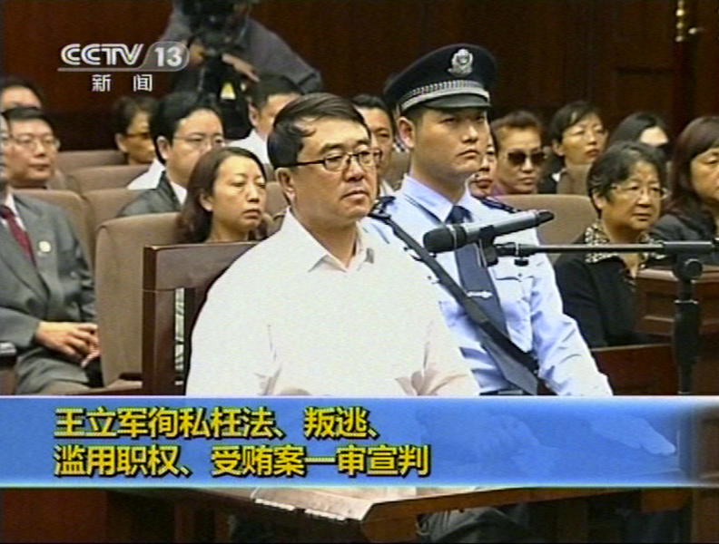 In this Sept. 24, 2012 video image taken from CCTV, Wang Lijun sits in the Intermediate People's Court during his trial in Chengdu, in southwestern China's Sichuan province. The Chinese police chief whose thwarted defection exposed murder and infighting in high places was sentenced to 15 years in prison Monday, setting the stage for China's leadership to close out the divisive scandal and move ahead with a generational handover of power. (AP Photo/CCTV via AP video) CHINA OUT, TV OUT