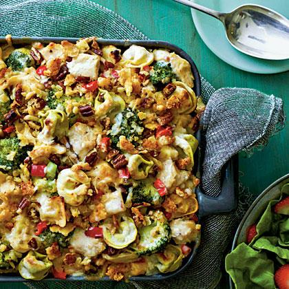 """Cheese-filled tortellini and a chopped pecan topping add extra flavor to kid-friendly Pasta-Chicken-Broccoli Bake, while broccoli and red bell pepper contribute pops of color throughout this one-dish meal. <a rel=""""nofollow"""" href=""""http://www.myrecipes.com/recipe/pasta-chicken-broccoli-bake"""">Pasta-Chicken-Broccoli Bake</a>"""