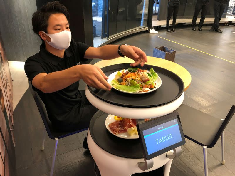 SoftBank's robotics arm demonstrates a food service robot Servi, developed for restaurants grapple with labour shortages and seek to ensure social distancing during the coronavirus disease (COVID-19) outbreak, in T