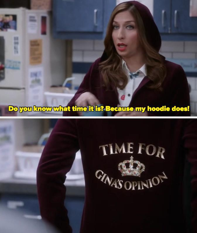 """Gina wearing a hoodie that says """"Time for Gina's opinion"""" and asking """"Do you know what time it is? Because my hoodie does!"""""""