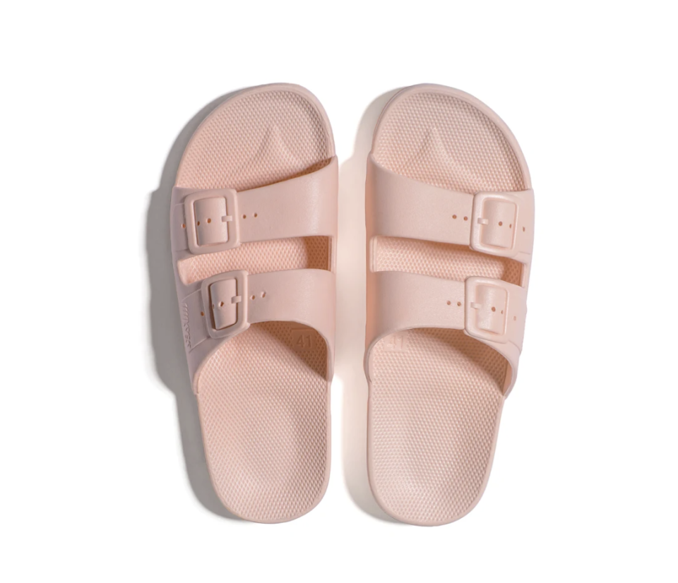 """<p><strong>Freedom Moses</strong></p><p>freedomoses.com</p><p><strong>$45.00</strong></p><p><a href=""""https://freedomoses.com/collections/women-slides/products/baby-slides?variant=39305527459901"""" rel=""""nofollow noopener"""" target=""""_blank"""" data-ylk=""""slk:Shop Now"""" class=""""link rapid-noclick-resp"""">Shop Now</a></p><p>A pair of slides they can easily slip on and off is perfect for dorm life.</p>"""