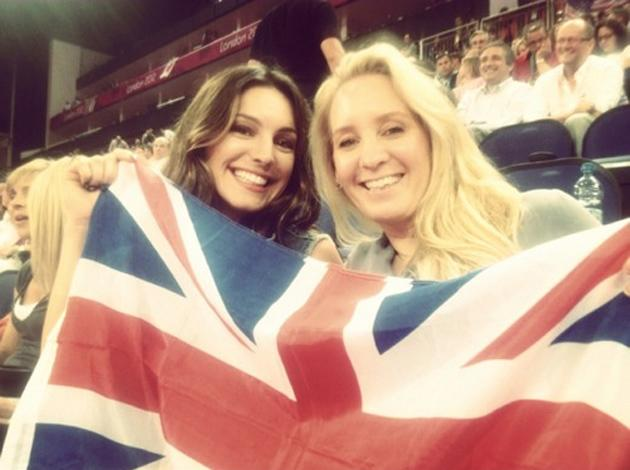 Celebrity photos: Kelly Brook got into the Olympics spirit as well, taking a friend and a massive union jack flag along to the games. She even tweeted that the female beach volleyball players were her 'gymspiration'.
