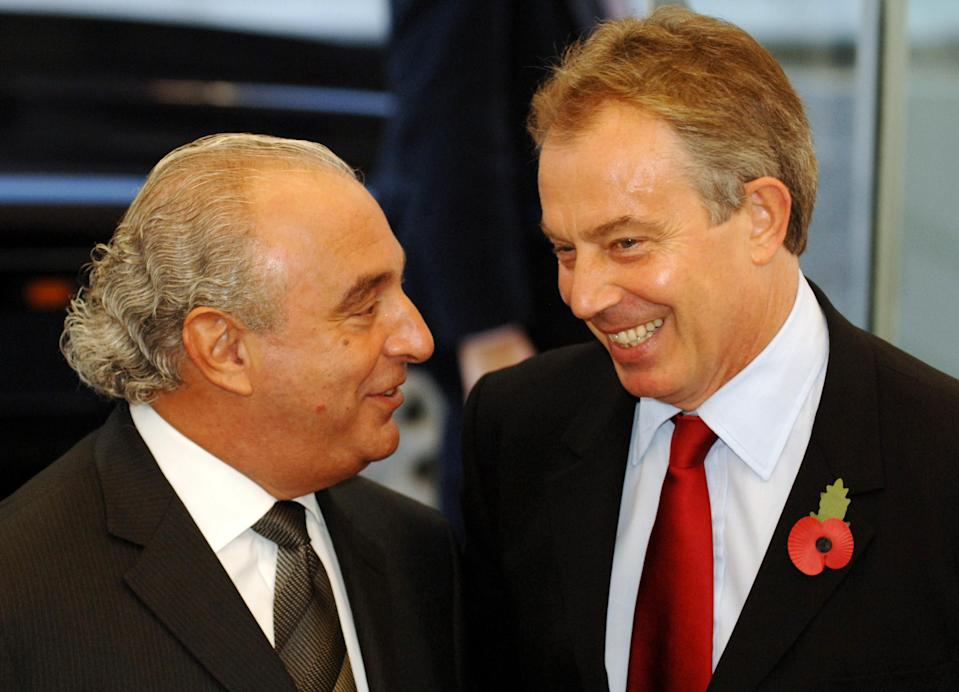 British Prime Minister Tony Blair (right) talks to Arcadia boss Sir Philip Green during a visit for the official opening of the Fashion Retail Academy in central London. PRESS ASSOCIATION Photo. Picture date: Tuesday October 31 2006. Sir Philip Green today offered Tony Blair a job when his premiership ends - in the fashion industry.The Arcadia boss made the proposition as the Prime Minister attended the opening of the Fashion Retail Academy's new buildings in central London. See PA story POLITICS Blair. Photo credit should read: Fiona Hanson/WPA rota/PA.