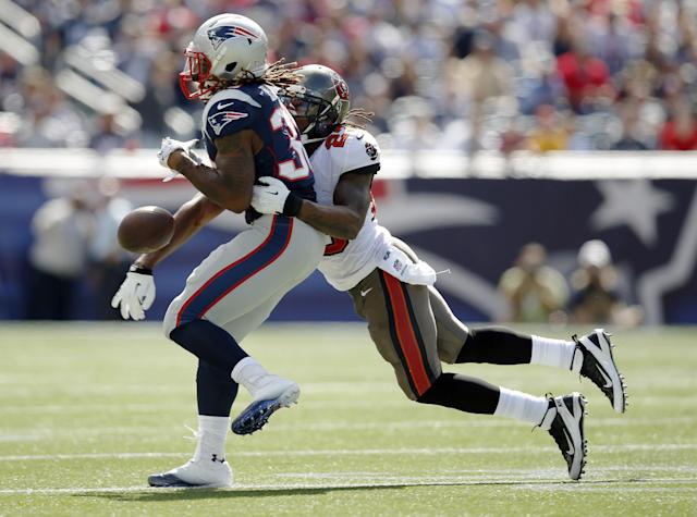 Tampa Bay Buccaneers strong safety Mark Barron (23) breaks up a pass intended for New England Patriots running back Brandon Bolden (38) in the first half of an NFL football game Sunday, Sept. 22, 2013, in Foxborough, Mass. (AP Photo/Elise Amendola)
