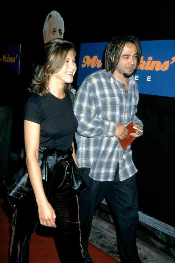 """American actress Jennifer Aniston and American musician Adam Duritz attend the """"Mr. Jenkins Soiree"""" at the Ace Gallery Los Angeles on September 29, 1995 in Los Angeles, California"""