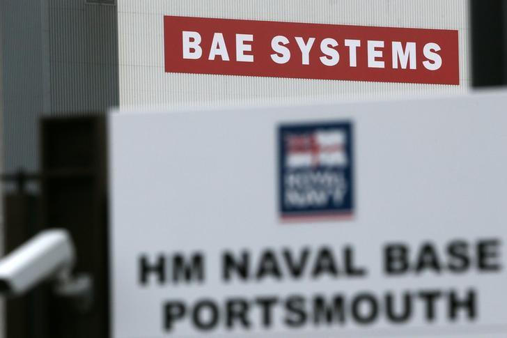 A BAE Systems sign is seen at the naval dockyards in Portsmouth