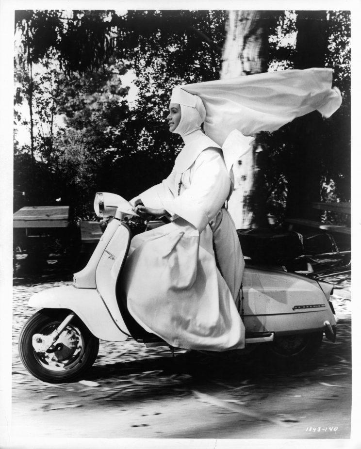 Debbie Reynolds riding motor bike in a scene from the film 'The Singing Nun', 1966. (Photo by Metro-Goldwyn-Mayer/Getty Images)