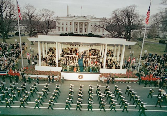 A military unit marches down Washington's Pennsylvania Avenue past the reviewing stand during the inaugural parade held after Ronald Reagan was sworn in as the nation's 40th president in Washington, D.C., Jan. 20, 1981. Visible in the background are the White House and the Washington Monument. (AP Photo)