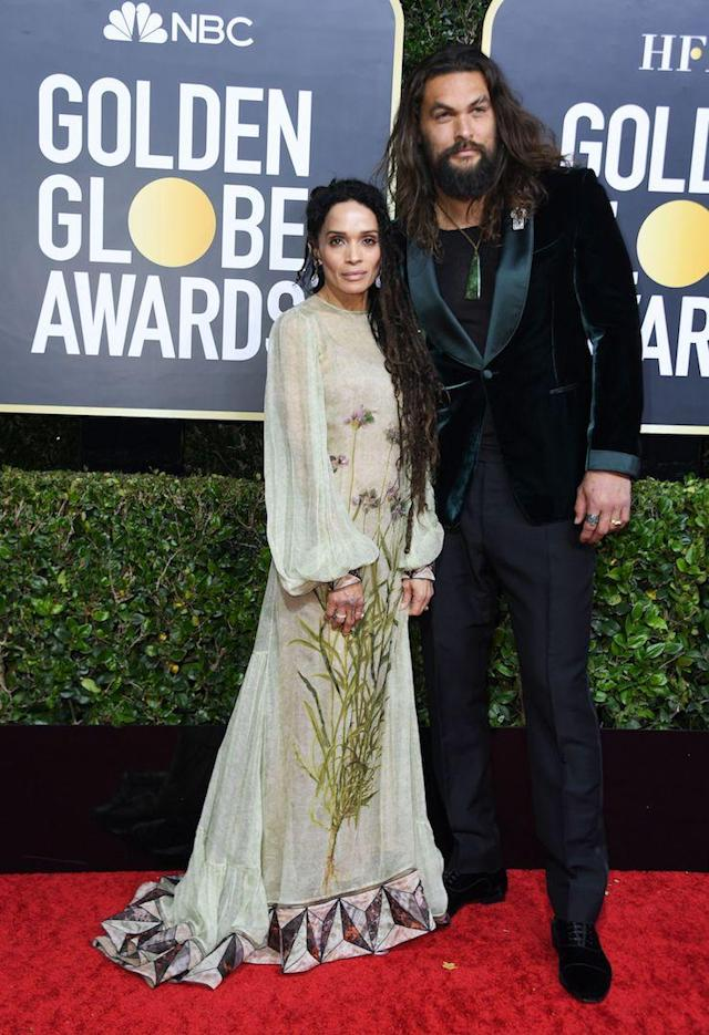 Jason Momoa is wearing a velvet tuxedo while Lisa Bonet chose a sheer floral gown. <em>[Photo: Getty]</em>