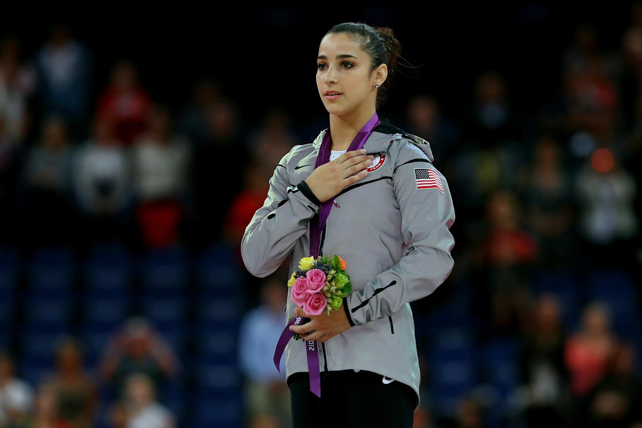 Gold medalist Alexandra Raisman of the United States poses on the podium during the medal ceremony for the Artistic Gymnastics Women's Floor Exercise final on Day 11 of the London 2012 Olympic Games at North Greenwich Arena on August 7, 2012 in London, England.  (Photo by Ronald Martinez/Getty Images)