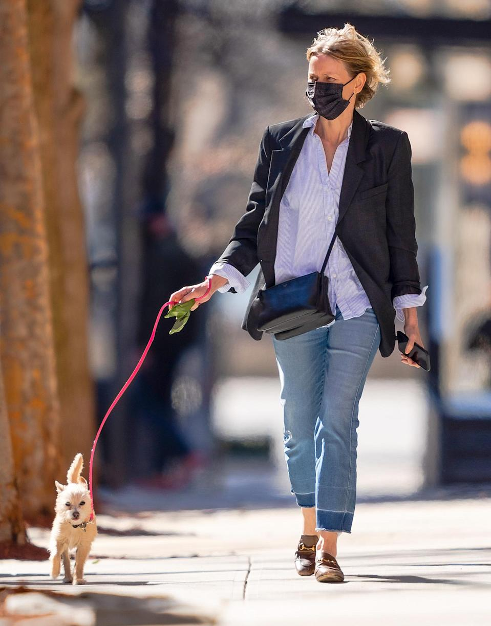 <p>Naomi Watts and her pup soak up the sunshine during a walk around N.Y.C. on Wednesday.</p>