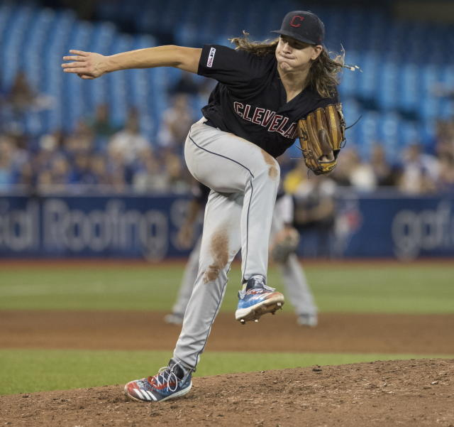 Cleveland Indians starting pitcher Mikel Clevinger throws against the Toronto Blue Jays during sixth-inning baseball game action in Toronto, Monday, July 22, 2019. (Fred Thornhill/The Canadian Press via AP)