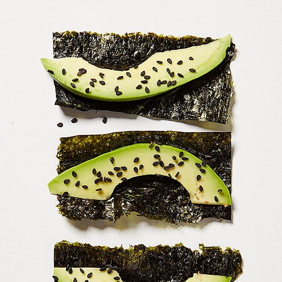 """<p>Top squares of nori with sliced avocado and a sprinkle of sesame seeds for a savory snack that's chewy, creamy, and crunchy, says Stephanie Middleberg, R.D.N., the founder of <a rel=""""nofollow"""" href=""""http://middlebergnutrition.com/"""">Middleberg Nutrition</a> in New York City. Seaweed is rich in vitamins and minerals, and avocado is full of healthy fat.</p>"""
