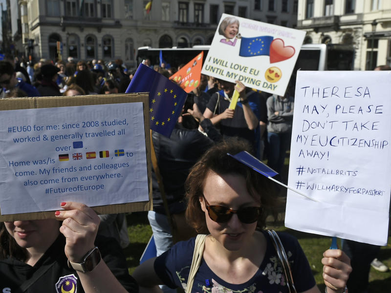 A lost cause? Pro-EU protester holds up placard against Brexit in Rome ahead of 60th anniversary celebrations: John Thys/AFP/Getty Images
