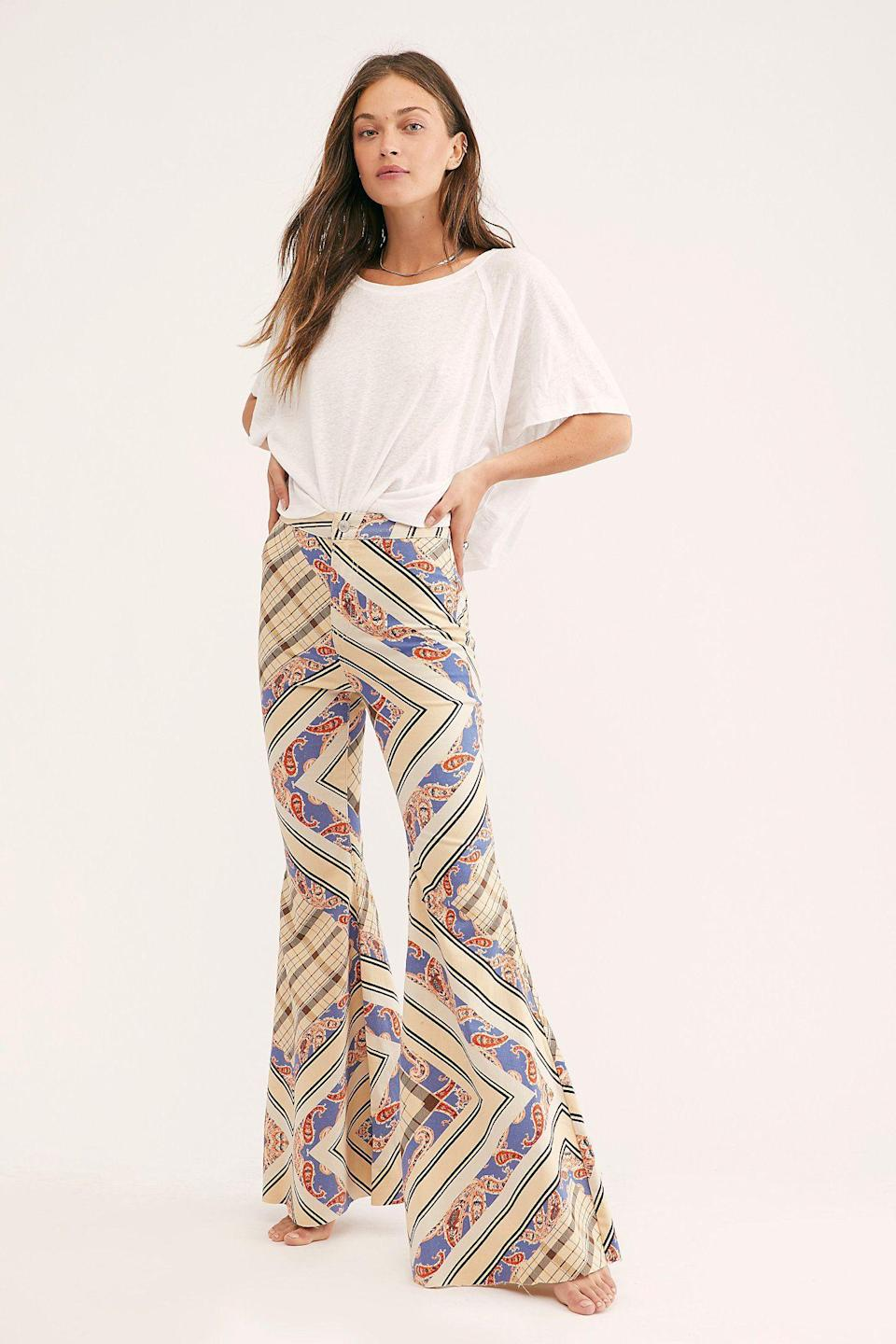"""<p><strong>We The Free</strong></p><p>freepeople.com</p><p><strong>$98.00</strong></p><p><a href=""""https://go.redirectingat.com?id=74968X1596630&url=https%3A%2F%2Fwww.freepeople.com%2Fshop%2Fjust-float-on-printed-flare-jeans%2F&sref=https%3A%2F%2Fwww.goodhousekeeping.com%2Fholidays%2Fhalloween-ideas%2Fg27952017%2Fbest-hippie-halloween-costume-ideas%2F"""" rel=""""nofollow noopener"""" target=""""_blank"""" data-ylk=""""slk:Shop Now"""" class=""""link rapid-noclick-resp"""">Shop Now</a></p><p>These flare jeans come in 10 different prints so you can find the one that not only fits your costume, but also one that you'll wear again. </p>"""
