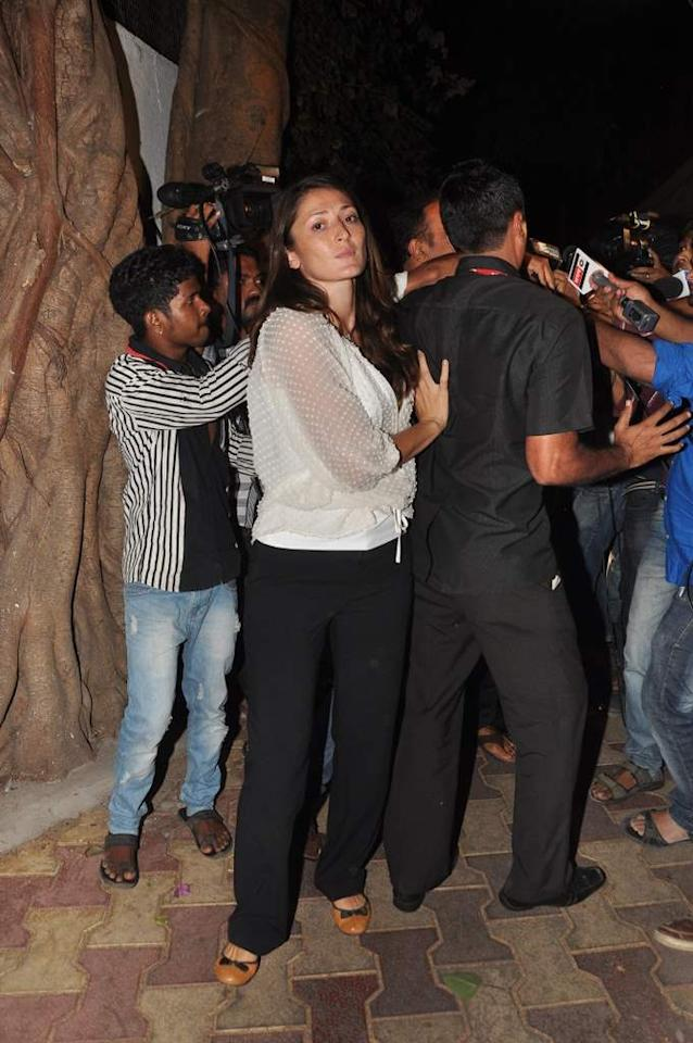 Dina Umarova, wife of Vindoo Dara Singh, looks on as her husband talks to reporters after being released on bail in Mumbai on June 4. (Sanskrity Media)