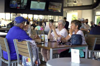 Baseball fans gather in the Bullpen Club at George M. Steinbrenner Field before a spring training exhibition baseball game between the New York Yankees and the Toronto Blue Jays in Tampa, Fla., Wednesday, March 24, 2021. Spring has arrived, and many older adults who have been vaccinated are emerging from hibernation imposed by the coronavirus pandemic.(AP Photo/Gene J. Puskar)
