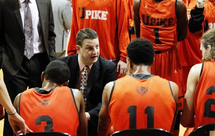 Kelly Wells (center, facing forward) says his decision to give up the head coaching job for University of Pikeville men's basketball after the 2019-20 season gave him more time to spend with his parents in what turned out to be their final months.