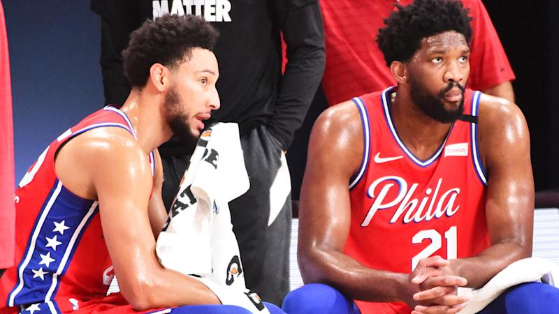 Ben Simmons is pictured in conversation with Philadelphia 76ers teammate Joel Embiid.
