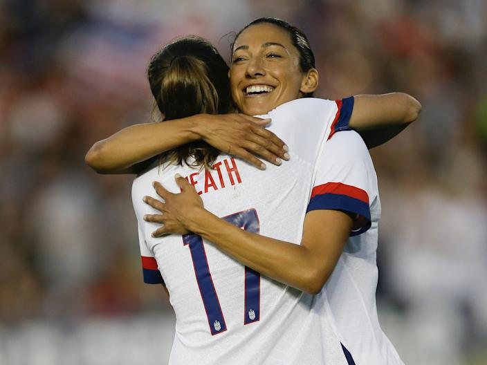 Christen Press hugs USWNT teammate Tobin Heath.