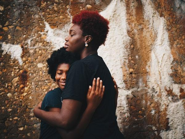 Mothering Daughters Is Much More Complex Than Sparkles, Shopping Sprees, And Princesses: Two women, and mother and daughter hugging