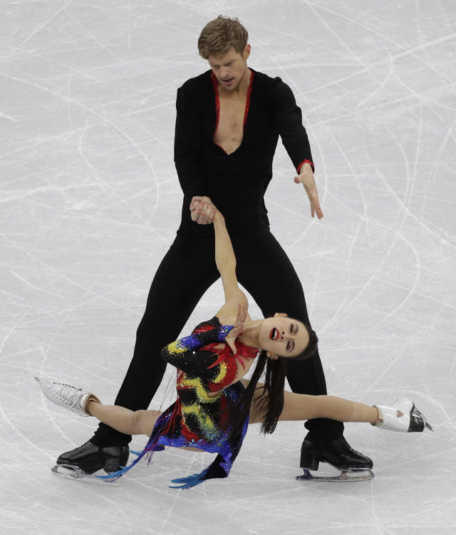 <p>Madison Chock and Evan Bates of the United States perform during the ice dance, short dance figure skating in the Gangneung Ice Arena at the 2018 Winter Olympics in Gangneung, South Korea, Monday, Feb. 19, 2018. (AP Photo/David J. Phillip) </p>