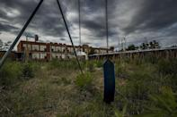 "<p>A swing sits unhinged in front of an empty school building.</p><p>Photo: Flickr/<a href=""https://www.flickr.com/photos/141333312@N03/40500182250/in/photostream/"" rel=""nofollow noopener"" target=""_blank"" data-ylk=""slk:Trevor Marrons"" class=""link rapid-noclick-resp"">Trevor Marrons</a></p>"