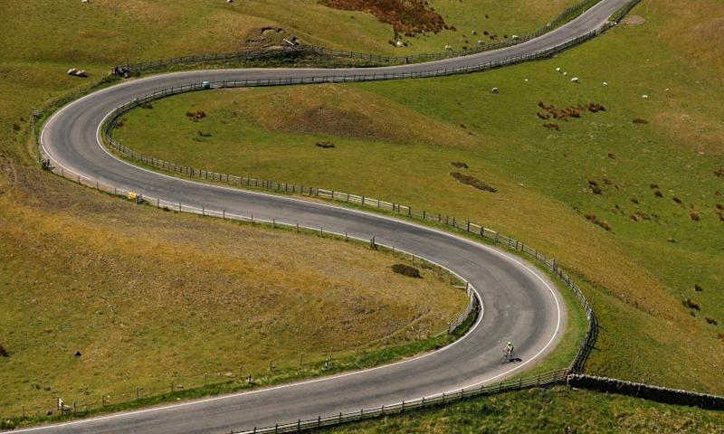 A cyclist is seen on a road in the Peak District National Park, following the outbreak of the coronavirus disease (COVID-19), Mam Tor..